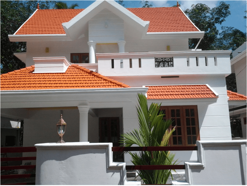 Medium budget home design in karukutty 1700 sq ft home for Car porch design in kerala