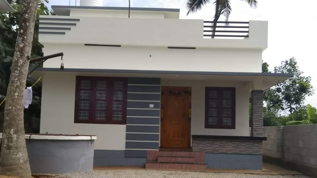 Photo of 700 Square Feet 2 Bedroom Kerala Style Single Floor House and Plan