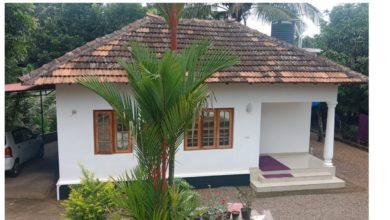 Photo of 1200 Square Feet 3 Bedroom Kerala Traditional Style House in 14 Cent Land